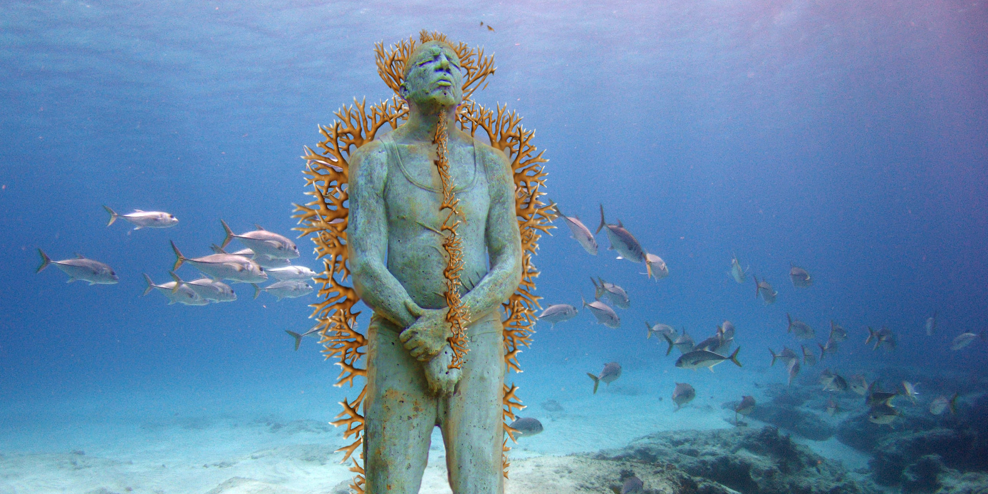 CANCUN, MEXICO - JANUARY 31: ***EXCLUSIVE*** Hombre en Llamas (Man on Fire) depicts a lone figure standing upright and defiant. The sculpture is installed 8m deep in the clear Caribbean waters surrounding the island of Isla Mujeres at a location named Manchiones. The cement figure has been drilled with over 75 holes and is currently being planted with live cuttings of fire coral (Millepora alcicorni). January 31, 2005. Deep under the seas of the Mexican Caribbean these statues look like relics of an ancient civilisation. Located in the National Marine Park, on the west coast of Isla Mujeres, Punta Cancun and Punta Nizuc, it will be the world's largest undetwater sculpture museum. Showing three life size sculptures are the first of 400 that will be laid on the seabed over the next 13 months. Founded by Jaime Gonzalez Cano of The National Marine Park, Roberto Diaz of The Cancun Nautical Association and renowned British underwater sculptor Jason deCaires Taylor, the underwater museum is designed to celebrate the Mayan history of the region and act as an artificial reef. (Photo by Jason de Caires / Barcroft Media / Getty Images)